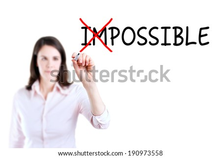 Businesswoman choosing Possible instead of Impossible.  - stock photo