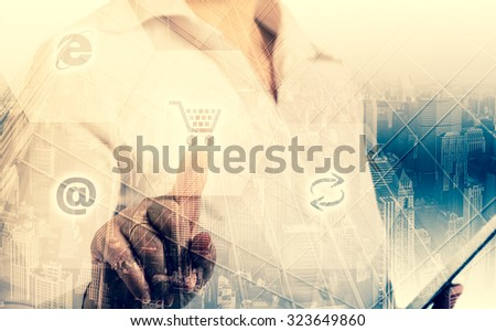 businesswoman choosing shopping cart symbol. double exposure. - stock photo