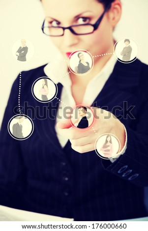Businesswoman choosing the right worker of all applicants on an abstract button. - stock photo