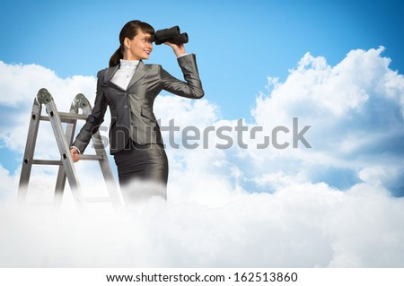businesswoman climbed a ladder and looking through binoculars - stock photo