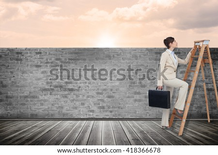 Businesswoman climbing career ladder with briefcase against a beautiful on a beach - stock photo