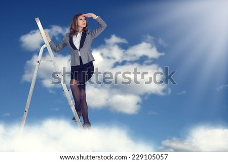 Businesswoman climbing the stairs to the sky looking into the distance.