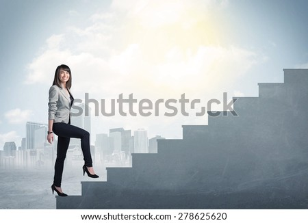 Businesswoman climbing up a concrete staircase concept on city background - stock photo