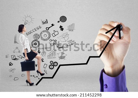 Businesswoman climbing upward chart to gain her business target by following businessman's hand - stock photo