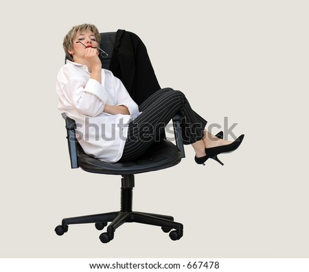 Businesswoman contemplating in her office chair - stock photo