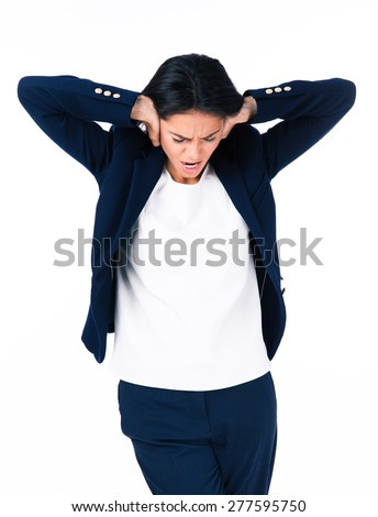 Businesswoman covering her ears over white background - stock photo