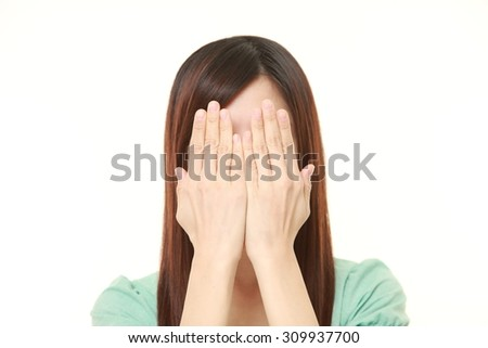 businesswoman covering her face with hands - stock photo