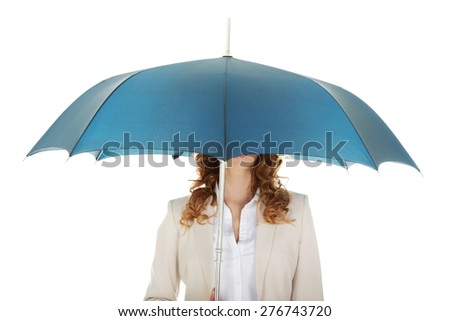 Businesswoman covering her head with umbrella.