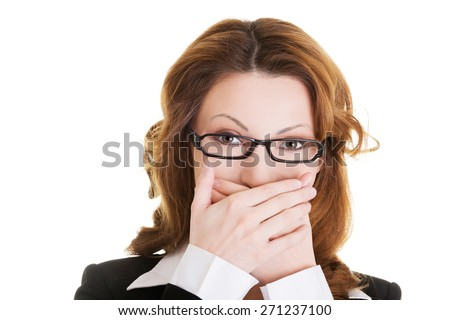Businesswoman covering her mouth because of shame. - stock photo