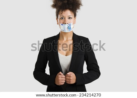 Businesswoman covering her mouth with a euro banknote, great concept for the global crises - stock photo