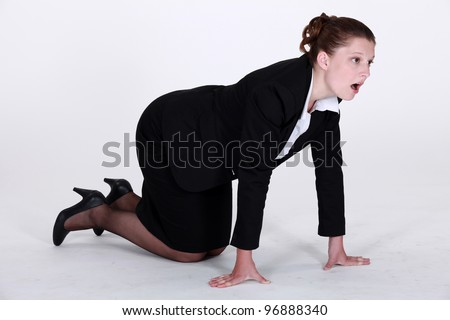 Businesswoman crawling on the floor - stock photo