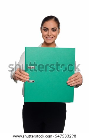 Businesswoman demonstrates a business plan in green folder. Beauty with an amazing smile is in the blurred background.