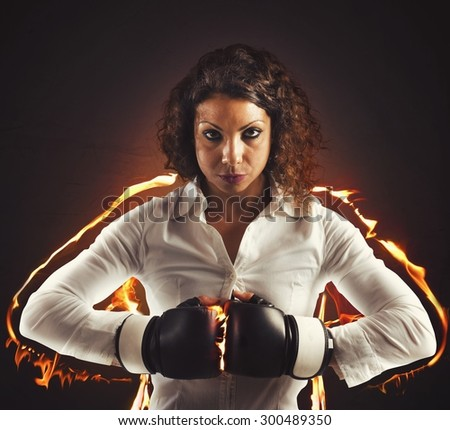 Businesswoman determined and confident with boxing gloves - stock photo
