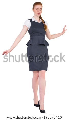 Businesswoman doing a balancing act on white background
