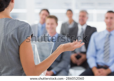 Businesswoman doing conference presentation in meeting room - stock photo