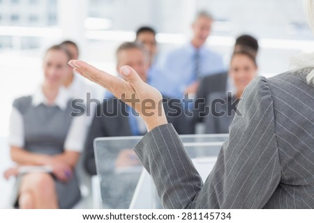 Businesswoman doing speech during meeting in office - stock photo
