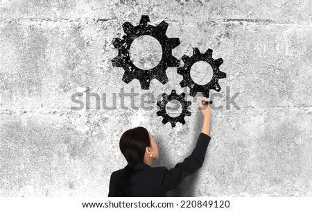 businesswoman draw gear concept - stock photo