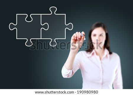 Businesswoman drawing a Blank Puzzle on the screen.