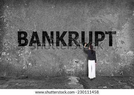 businesswoman drawing bankrupt on wall