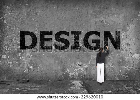 businesswoman drawing design on the wall