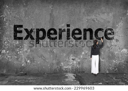 businesswoman drawing experience on the wall