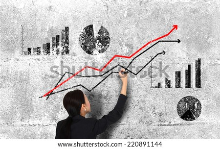Businesswoman Drawing Graph On Wall Creativity Concept - stock photo