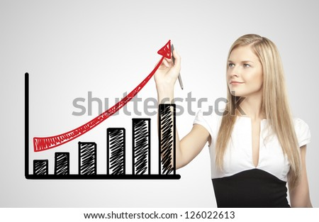 businesswoman drawing growth of chart