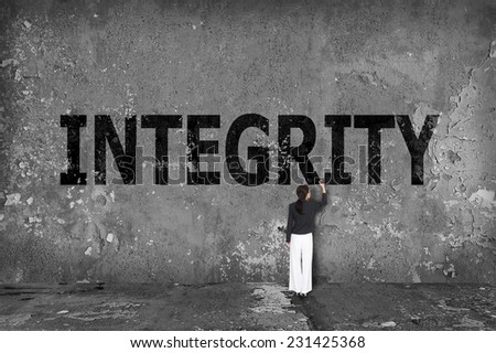 businesswoman drawing integrity on the wall