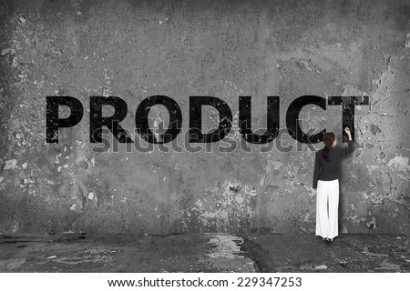 businesswoman drawing product on the wall