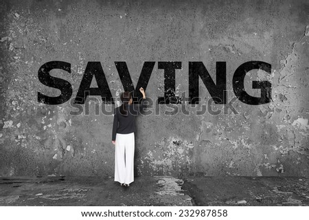 businesswoman drawing  saving on the wall