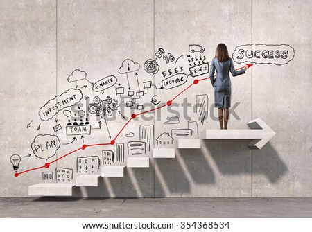 Businesswoman drawing strategy plan over ladder leading to success - stock photo