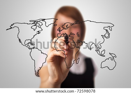 businesswoman drawing the world map in a whiteboard (on bokeh) - stock photo