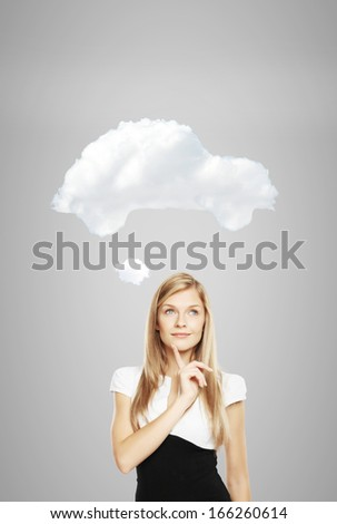 businesswoman dreaming of a new car - stock photo