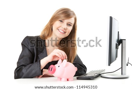 businesswoman dropping coin into piggy bank, white background - stock photo