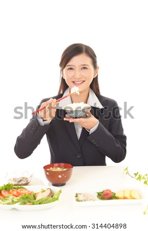 Businesswoman eating meals