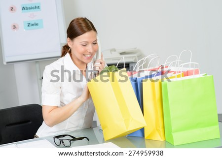 businesswoman enjoy her purchase from online shopping