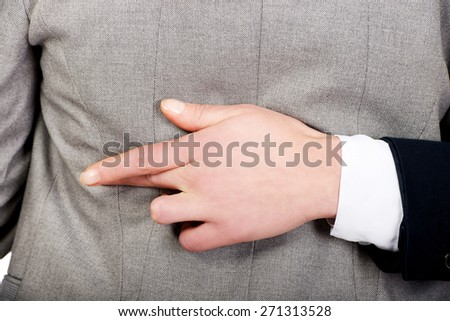 Businesswoman fake fingers crossed while embracing. - stock photo