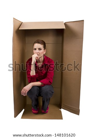 Businesswoman Feeling Boxed In - stock photo
