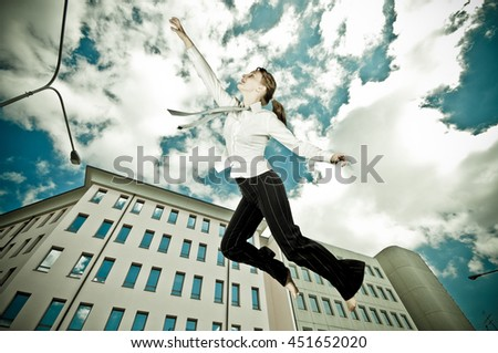 businesswoman flying in a urban landscape reaching the sky
