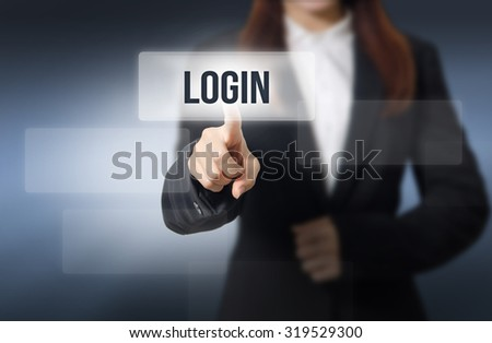 Businesswoman, Focus on hand pointing LOGIN word on virtual screen  - stock photo