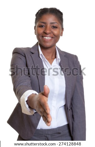 Businesswoman from Africa giving hand - stock photo