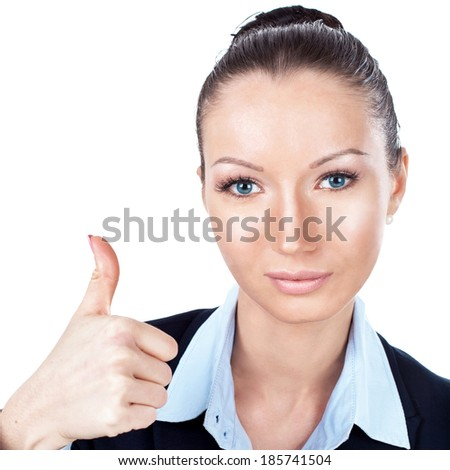 Businesswoman gesturing with a thumbs up - stock photo