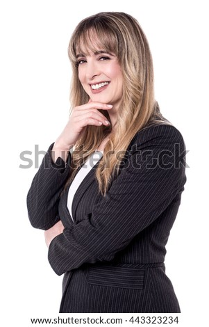 Businesswoman giving a cute pose to camera. - stock photo