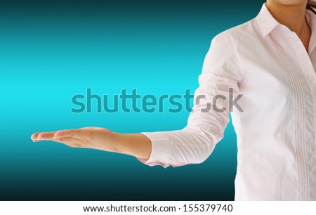 businesswoman giving a hand - stock photo