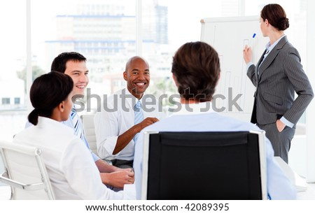 Businesswoman giving a presentation to her team in the office