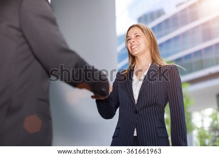 Businesswoman giving an handshake