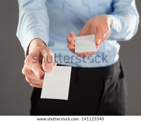 Businesswoman giving business card to you, you can add your text on it - stock photo