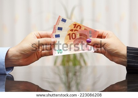 Businesswoman giving euro banknotes  to man . Salary concept - stock photo