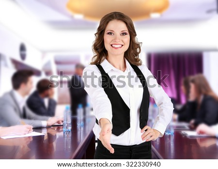 Businesswoman giving his hand for a handshake and business people - stock photo