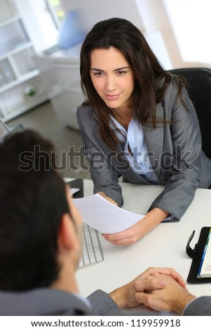 Businesswoman giving job interview - stock photo